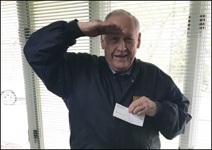 Frank Lomago from the Mon Valley Honor Guard and Firing Squad makes a donation to the Monongahela Cemetery Chapel Restoration Fund.