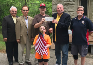 Before decorating the Veteran's graves for Memorial Day David Thompson, Jr., Commander of the American Legion, Frank Downer Post 302, makes a donation to the Monongahela Cemetery Chapel Restoration Fund. Standing in the back row left to right Roger D'Emidio, Richard Bucchianeri, David Thompson, Jr., John Cattaneo, and Stuart Isaac of American Legion Post Frank Downer 302. In front is Alex Thompson.