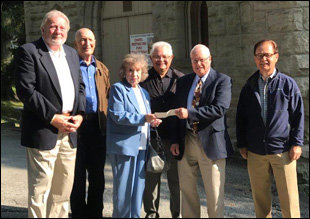 Mr. and Mrs. Wes Cramer make a personal donation to President James McCune and Vice-President-Secretary John Cattaneo for the Monongahela Cemetery Chapel Restoration Fund